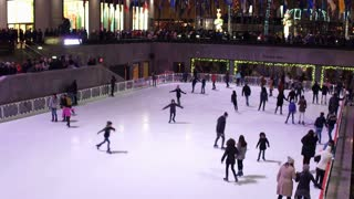 People at ice skating in rink at Rockefeller Center