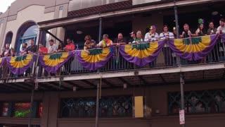 People celebrating Mardi Gras on Bourbon Street 4k