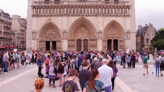People in line waiting to get in to Notre Dame Cathedral Paris 4k