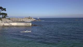People Kayaking in ocean leaving from Lovers Point Beach 4k
