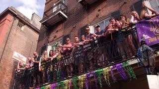 People on balcony celebrating Mardi Gras 2018 4k