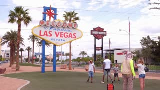 People visiting Welcome to Las Vegas sign taking photos 4k