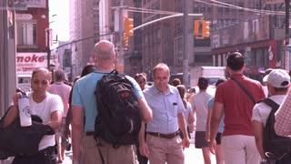 People walking down sidewalk slow motion NYC