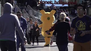 Pikachu and Hello Kitty in front of Planet Hollywood Las Vegas 4k
