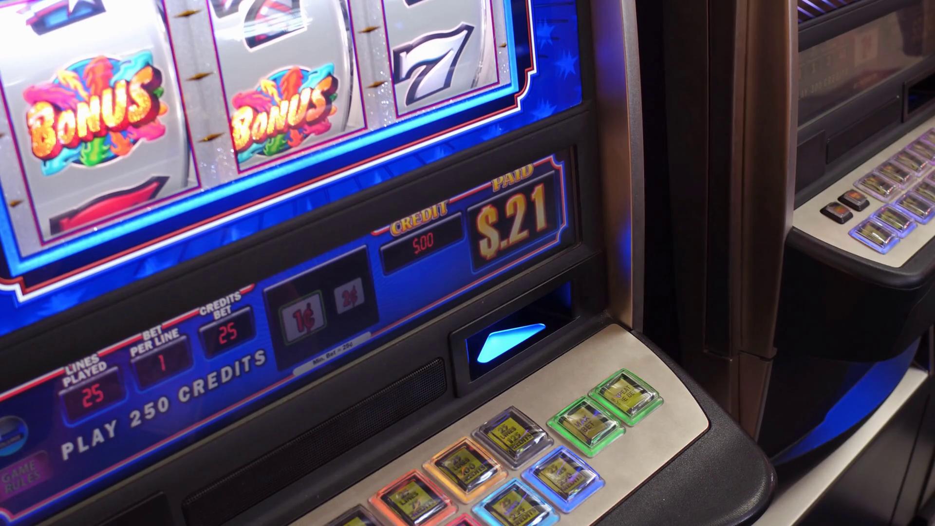 Player inserting money into casino gambling slot machine 4k Stock Video  Footage - Storyblocks