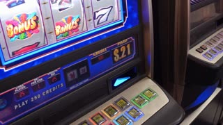 Player inserting money into casino gambling slot machine 4k