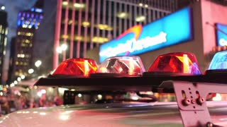 Police lights flashing in downtown with city background 4k