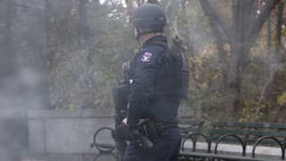 Police officers of the NYPD standing guard after Macys Parade 4k