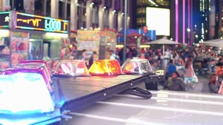 Police vehicle with flashing lights in downtown New York City 4k