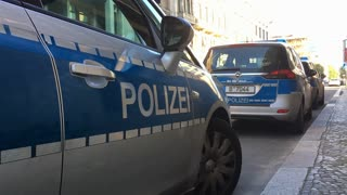 Polizei cars parked along side of Berlin streets