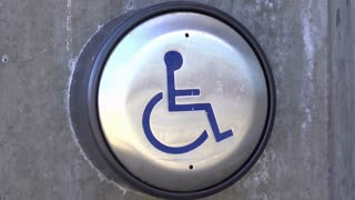Pressing automated handicap door entrance button 4k