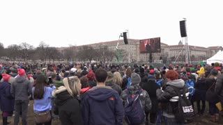 Quiet crowd at inauguration watching Donald Trump on television 4k