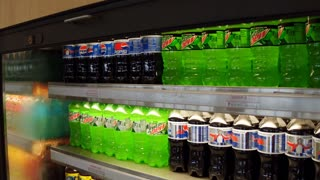 Refreshing beverages in store cooler for sale 4k