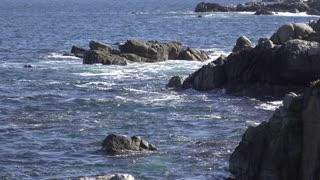 Rocks along coastline of ocean water 4k