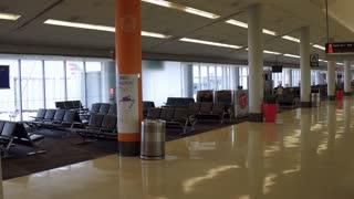 Seating area in airport terminal at gate Philadelphia 4k