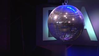 Shiny disco ball rotating with flashing lights 4k