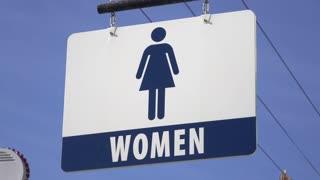 Sign for Women restroom displayed outdoors at entrance 4k