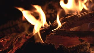 Slow motion flames burning wood close up