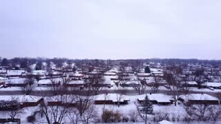 Small town traffic going on main street on winter day aerial view 4k