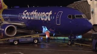 Southwest flight preparing at night in Denver Colorado 4k