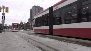 Street car entering station with passengers arriving Toronto Canada 4k