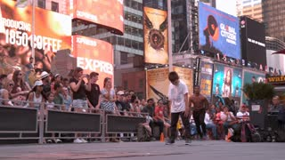 Street performer does flip over kid in Times Square slow motion