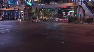 Street to Las Vegas dark night tilt establishing shot 4k