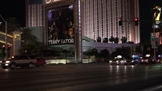 Street traffic in downtown Las Vegas in front of large casino 4k