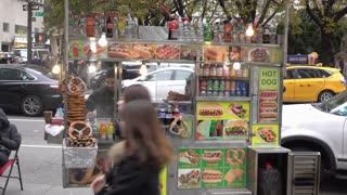 Street vendor selling food in NYC sidewalk 4k