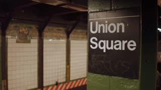 Subway train arriving into Union Square Station with passengers boarding 4k