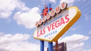 Sunny day establishing shot of Welcome to Las Vegas sign 4k