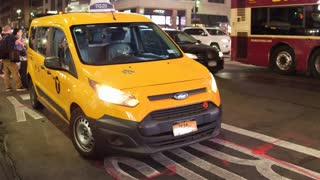 Taxi parked at sidewalk of downtown New York City 4k