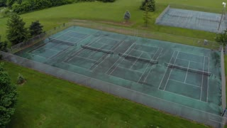 Tennis courts on cloudy rainy day