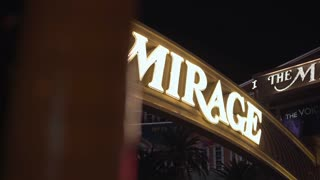The Mirage casino entrance with bright sign reveal 4k