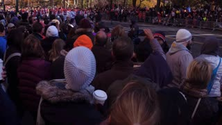 Tilt from crowd to Red Angry Bird in 91st Macys parade 4k