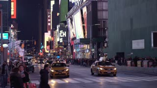 Times Square exterior establishing shot with traffic 4k