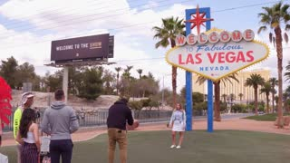 Tourists posing in front of Las Vegas sign 4k