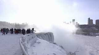 Tourists visiting ice cold and frozen Niagara Falls 4k