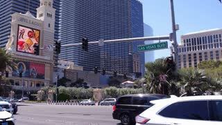 Traffic going down Las Vegas Blvd casino strip 4k
