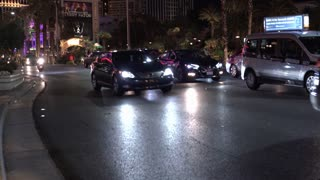 Traffic going down Las Vegas Boulevard with lit up casinos at night 4k