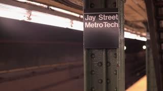 Train enters Jay Street Metro Tech subway stop in New York City 4k