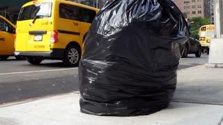 Trash bag to city traffic crane shot New York 4k