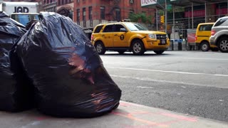 Trash bags along busy city streets in downtown NYC 4k