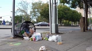 Trash littered on city sidewalk of downtown New York 4k