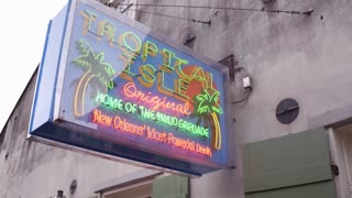 Tropical Isle store location on Bourbon Street during Mardi Gras 4k