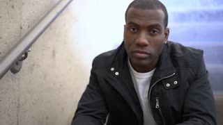 Troubled African American Male sitting in stairwell 4k