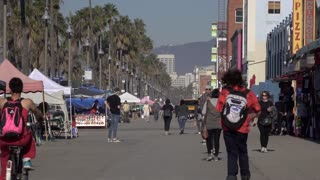 Typical Venice Beach California day with people on sidewalk 4k