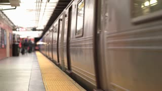 Underground subway train stopping at station 4k