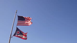 United States and Ohio State flag waving in wind 4k