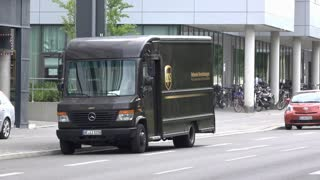 UPS delivery truck dropping off in downtown Munich Germany 4k